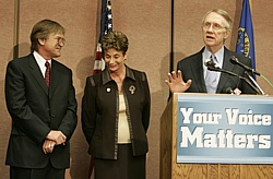 Bob Loux, left, and Rep. Shelley Berkley listen as Nevada Sen. Harry Reid speaks at a news conference on Yucca Mountain in 2006. Reid says Loux's entire career should be weighed as his fate is decided